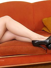 Hot leggy Milf Heidi is ready and waiting under her Christmas tree wearing a pair of tall black stiletto heels