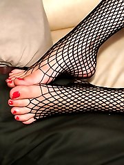 Leggy girl in fishnet pantyhose footjobs a stiff dick then gets toes sucked by old dude