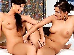 Sensual lesbian brunettes kissing