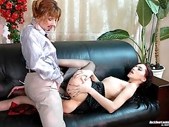 Mischievous lesbian babe in male suit cramming tight bumhole on the sofa