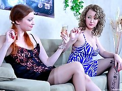 Redheaded and blonde lesbians slowly strip off while enjoying tongue kisses