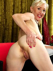 Horny granny Tina spreads mature pussy wide open.