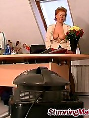 Mature lady-boss summoning her worker and getting down right in the office