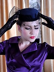 Classy seductress smoothens fine hosiery on her legs with her gloved hands