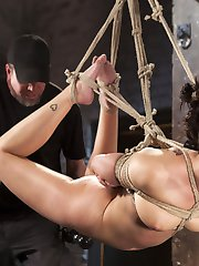 Ava finds herself tied with her hands above her head and her legs spread wide. Her all natural...