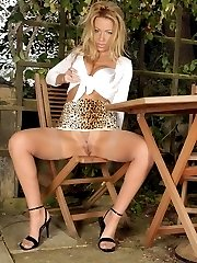 Taylor relaxes in her garden, gets turned on in the warm sun, stripping down to her mini girdle...