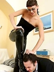 Lustful lady boss forcing her worker to boot licking before deep strapon fucking
