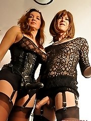 Strapon Jane takes naughty crossdresser Emily from behind with her big black strapon