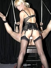 Innocent looking blonde Mistress penetrates male slave using a very big strap-on dildo very...