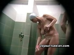 Hot MILF with unnaturally large rack filmed all wet and glistening in shower