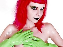 redhead naked and spread with bright latex gloves
