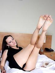 hot brunette making sexy footjob