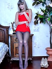 Sultry babe shows off her sexy stiletto heels and red painted nyloned toes