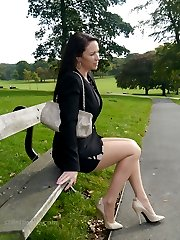 A tight black dress and creamy high stiletto heels gets this dark haired beauty in the mood for some outdoor fun