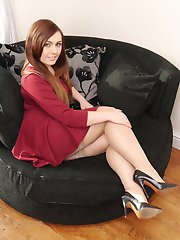 Lovely Lauryn is wearing a pair of shiny nylons and gorgeous black high heel stilettos over her shapely legs