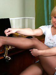 Blondie savors the scent of her feet encased in reinforced toe pantyhose