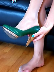 Hot gal enjoys every touch on her nyloned pedicured feet right on the stairs