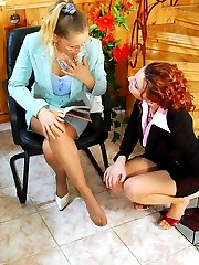 Lesbian chicks pleasuring their feet in silky pantyhose right on the stairs