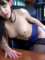 Naughty office girl spread-eagles in black stockings to stuff her asshole