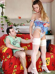 Long-haired chick in lacy stockings rubbing her clit and gagging on pecker
