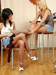 Babes in smooth tights playing with hosiery and rubbing each others pussies