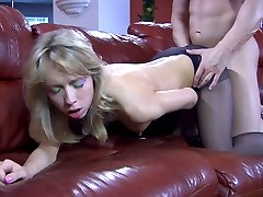Smartly dressed blonde parts her pantyhosed legs for a horny studly dude