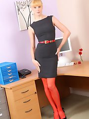 Joceline poses in her tight grey dress before stripping down to just her sheer red stockings and heels.
