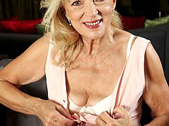 Horny granny Janet Lesley spreads her older pussy.