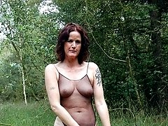 Slim granny stripping down in the forest so she could wear her body stockings
