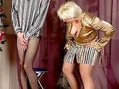 Lascivious mature chick and hot guy playing pantyhose games on the floor