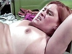 Mature redhead spreading wide to have her pussy pumped hard