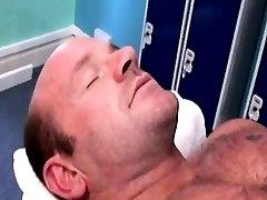 Musclular stud hunk masseur rubs client