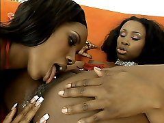 Hot black Kianna Jayde licks a wet ebony pussy in this hot lesbian ebony loving