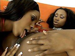 Hot black Kianna Jayde licks a wet ebony pussy in this hot lesbian ebony loving