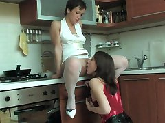 Heated sapphic chick in red stockings dipping her tongue into yummy twat