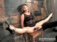 Welcome Chanel back to HogTied. In this update, she is given unpleasant but totally hot predicament bondage. In the first scene, she is perched with her tits on top of the ass less chair. Her head is encased in nylon, her nipple clamps tied to her neck, and the nylon to her chest harness. If she ties to see the torment or not react to the pain, she jerks her sensitive nipples and fabulous breasts. The chair is laid down and so is she... on her back again like the dirty whore she is. Chanel quickly discovers in this position she can\'t close her legs. Claire pounds her cunt milking sweet cum out of her cunt hole. In scene two, Chanel is given a booty tie to pop her ass out and oiled up like Sunday dinner. Claire goes after her with the flip cat and yet again, Chanel can\'t seem to close her legs with them bound so tightly to the wooden spreader bar. She cums again and again at Claire\'s whim, whimpering and begging again and again for release. In the third position, she is bound to a wood table with holes. Her legs are bound together and toes tied up to the pulley. Its discovered this is the perfect position to mercilessly tickle this cunt. She tries to escape, but its completely useless. A dildo assaults her cunt. A vibe on her clit. It becomes apparent that this bitch was made for the playground.
