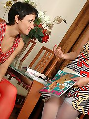 Red-stockinged girl caught by surprise by her friend eager for strap-on fun