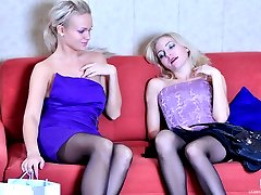 Blonde lesbians in dark stockings taste their wet pussies after hot kisses
