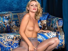 Luscious blonde Vanessa gets horny in a special pair of pantyhose, glossy grey with a pretty...