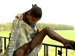 Beautifully dressed girl rams a big dildo thru her gorgeous fashion tights