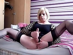 Tgirl Holly cums and fingers her ass