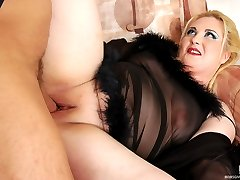 Older blond fatty in see-thru night-wear spreading her mounds for butt fuck