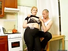 Horny son seduces his charming mature mom while she cooks
