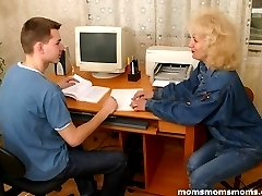 Housewife pays a technician lad