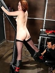 Lilla Katt is chained up as Sir Nik Satanas paddles her ass, really hard. He flogs her, then...