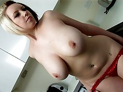 Lily Pink gets naked in the kitchen and oils her big puppies