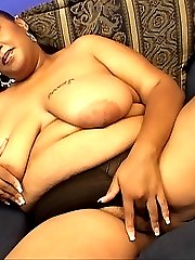 Kinky ebony fatties Snapps and Beauty strut massive tits before giving each other a wet pussy...