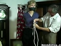 Frazier gags a woman and ties her precisely and meticulously. He ties her so tightly that,...