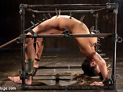 Big titted Nadia Styles submits to Orlando and his brutal bondage box. She is contorted,...
