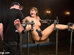 Charlotte is a fan girl who decided instead of watching bondage and masturbating all the time that she would join the industry and be part of it. This is her third shoot with me and it's time to put the brat in a fucking cage. I set the pace of the day by putting this slut on a pussy perch and spread her out wide. All of her weight rests on her slutty little cunt and it's evident that she is suffering immediately. Next she is in a floating seated position with her pussy fully exposed. Her feet are also on display and I ensure that this brat suffers with a brutal caning to her delicate soles. Her pussy and mouth get fucked and then her pussy squirts from over stimulation.In the final scene our brat has her arms and legs belted and the wrapped, but she is free to roll around, rather get thrown around and man handled. I use her like the slutty little piece of meat she is and when I'm finished with her I leave her writhing in the middle of the floor.